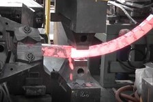 Production of Curved Workpiece by Superimposed Manipulator Displacements